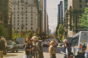 A city scene comprised of pedestrians, traffic and buildings representing Fon's presence in many countries | Fon