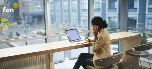 7 key trends that will define the future of WiFi as girl uses WiFi to browse and call | Fon