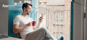 Man enjoying excellent WiFi coverage and experience on his mobile thanks to Fontech's Home WiFi Solution